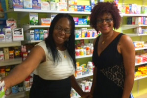 two women smiling in the pharmacy